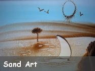 Disegni su sabbia o sand art