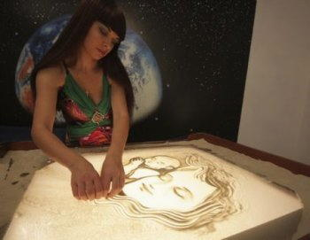 Sand art artista con light table 1