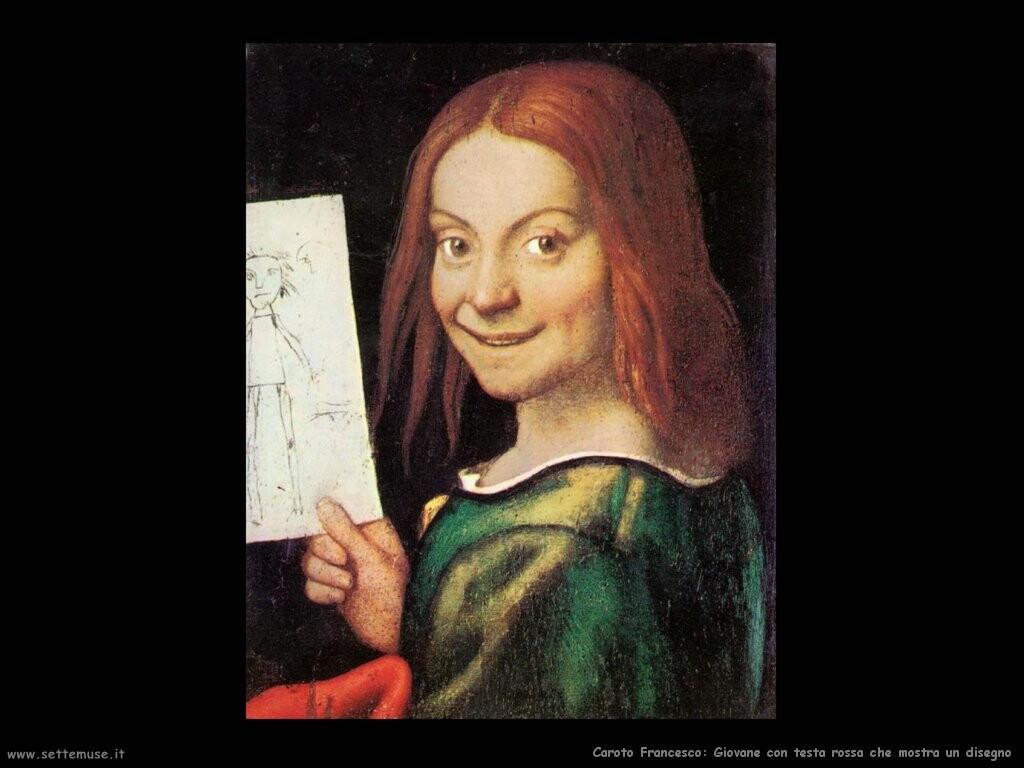 Giovane dalla testa rossa mostra un disegno