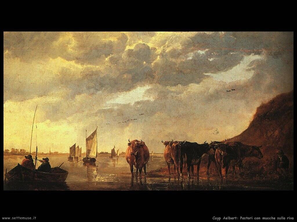 Pastore con mucche sul fiume