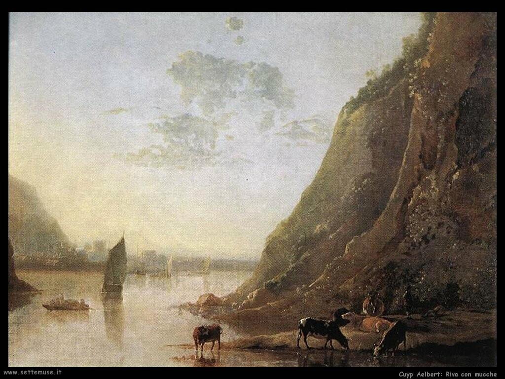 Sponda del fiume con mucche